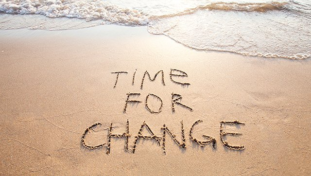 Time for change - written in sand on beach
